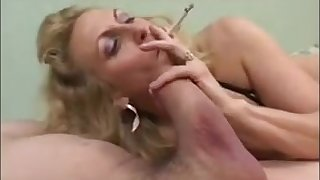 Comme �a milf giving blowjob while smoking increased by win cum on heart of hearts